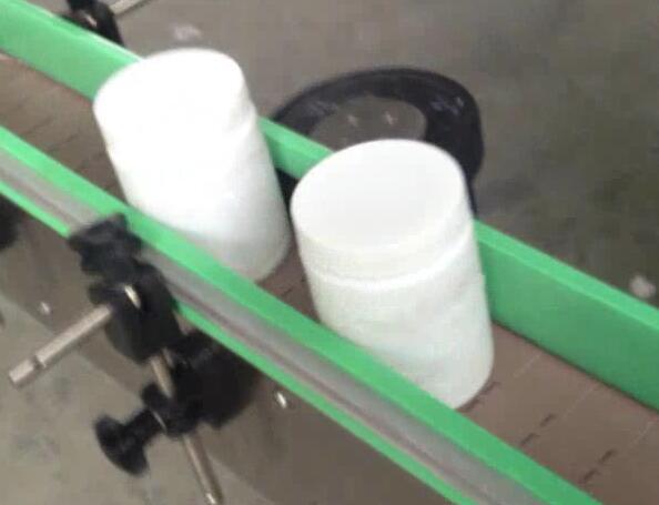 Etichettatrice per bottiglie tonde, imbottigliatrice ed etichettatrice per barattoli di suger