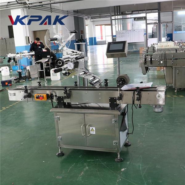 Applicatore automatico di etichette a superficie piana per sacchetti piatti per il lato superiore