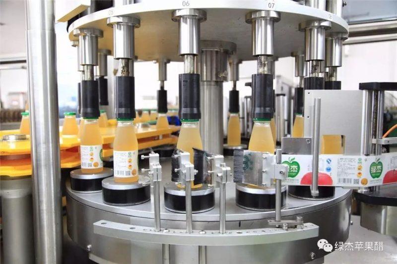 Cina Etichettatrice rotativa per bottiglie rotonde con sistema di etichettatura del piatto di rotazione fornitore