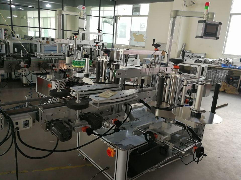 Sistema di etichettatura a doppia guarnizione ad angolo ad alta velocità per cartoni farmaceutici
